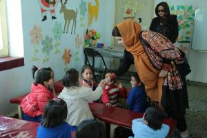 H.E. Ms. Kamila Sidiqi interacting with children at a day care center in Bamyan on Oct 15, 2017